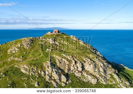 Torr Head Headland, Rocky Cliff And Peninsula With Ruins Of Old Fort In County Antrim, Northern Irel