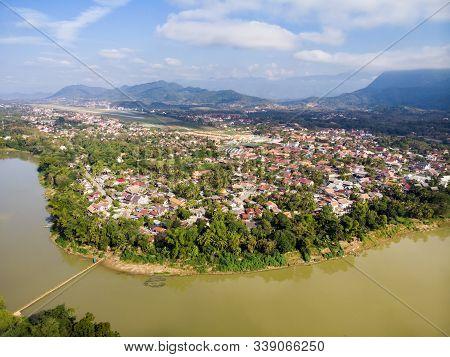 Luang Prabang, Laos. Aerial View Of Luang Prabang Town In Laos. Cloudy Sky Over The Small City Surro
