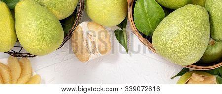 Fresh Peeled Pomelo, Pummelo, Grapefruit, Shaddock On Bright Wooden Background. Autumn Seasonal Frui