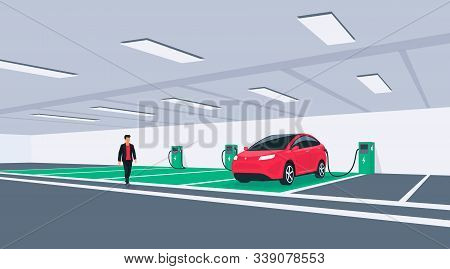 Electric Car Charging In Underground Basement Garage Garage On Wall Box Charger Stand. Battery Vehic