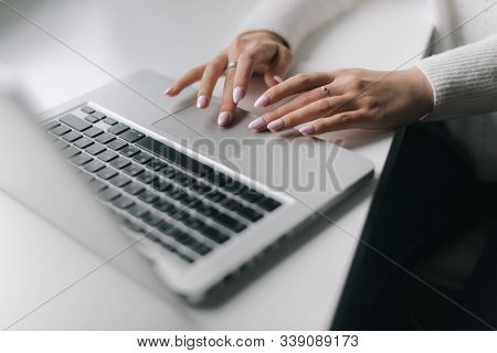 Woman Hands Are Typing On The Laptop Keyboard, Close-up. Focused Young Business Woman Professional C