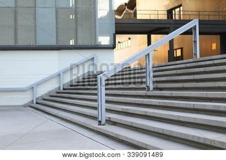 Stairs And Handrails To The Front Of The Building. Stairs And Handrails Made Of Steel.