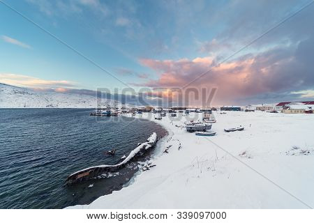 View Of The Old Russian Fishing Village Of Teriberka With A Shipwreck At The Mouth Of The Namesake R