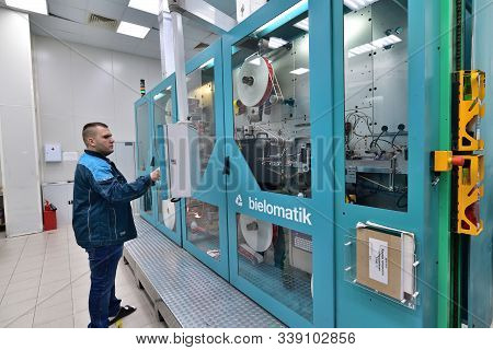 Moscow, Russia - Dec. 5.2019. Worker At The Machine In Mikron - Largest Plant For Production Of Chip