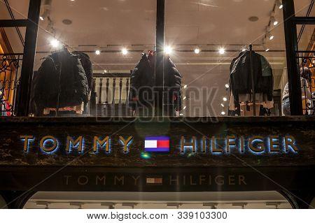Vienna, Austria - November 6, 2019: Tommy Hilfiger Logo On Their Local Boutique In Vienna. Tommy Hil
