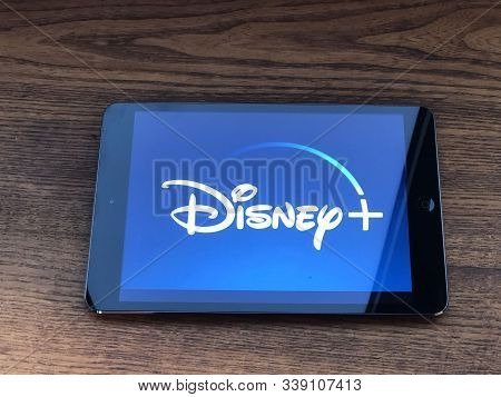 December 2019 Parma, Italy: Disney + Company Logo Icon On Tablet Screen Close-up. Disney+ Video Stre
