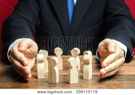 Businessman Defending His Team With A Gesture Of Protection. Care For Employees. Life Insurance. Sec