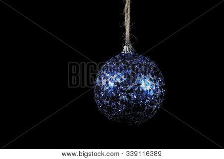 Close-up Glistening Blue Ball On Black Background, Christmas And New Year Decoration On Dark.