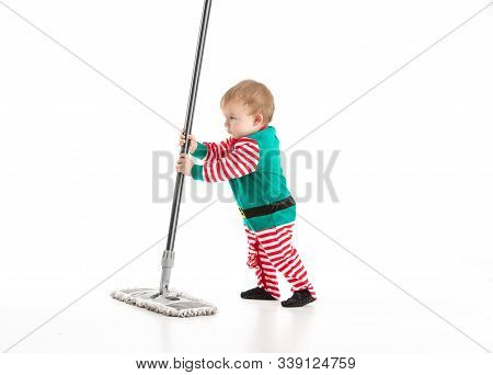 Studio Photo With White Background Of A Baby Disguised As A Elf Playing