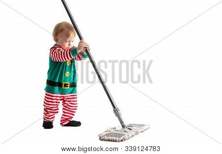 Stock Photo Of A Studio With White Background Of A Baby Disguised As A Goblin Playing With The Stick