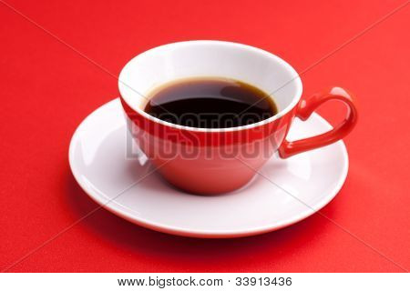 Cup Of Hot Coffee On A Red Background