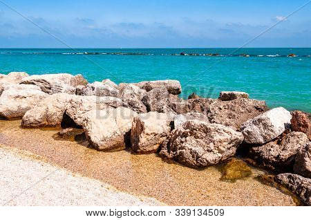 Massive Stones Rocks Lying On The Beach As A Border Between Pebble Beach Spiaggia Del Frate And Adri