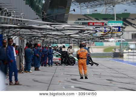 SEPANG - JUNE 10: Pit crew at work on race day at the 2012 Autobacs SUPER GT Series Round 3 on June 10, 2012 at the Sepang International Circuit, Malaysia. This race is part of the Japan GT series.
