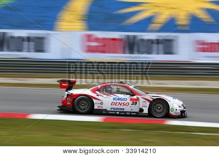 SEPANG - JUNE 9: The Denso Kobelco Lexus SC430 car of Lexus Team SARD races on the track at the 2012 Autobacs SUPER GT Series Round 3 on June 9, 2012 at the Sepang International Circuit, Malaysia.