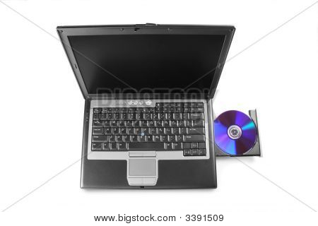 Laptop With Cd In Drive Isolated On White Background