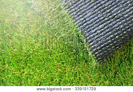 Artificial Grass Rolling. Artificial Turf Background. Copy Space.