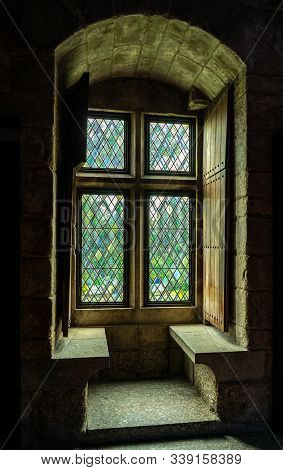 Thick Stone Walls Of The Palace Of The Dukes Of Braganza Wiht Window Seat In Guimaraes In Northern P