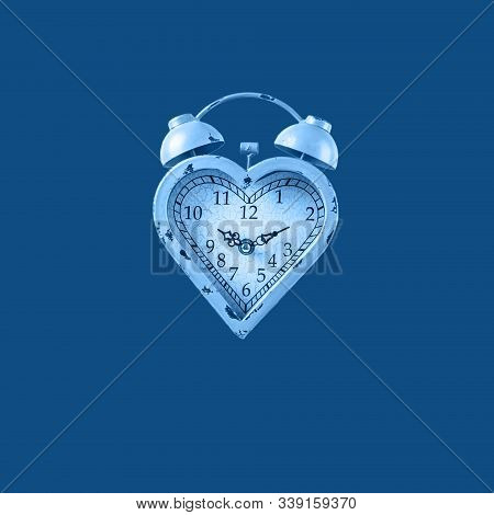 Heart Shaped Clock On Solid Background Toned In Classic Blue. Valentines Day And Love Infitity And D