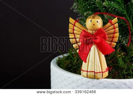 Figures Of Woodden Angel Under Christmass Tree With Copespace