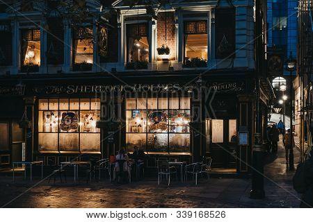 London, Uk - November 24, 2019: Illuminated Facade Of Sherlock Holmes Pub, A Traditional English Pub