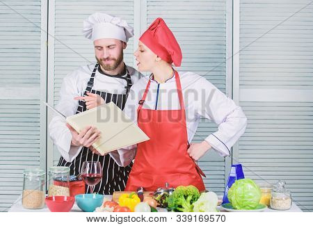 Woman Chef And Man Cooking Food Together. Culinary Family Concept. Couple In Love Cooking Healthy Re