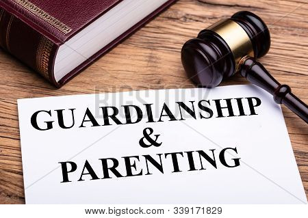 Overhead View Of Guardianship And Parenting Documents With Judge Gavel And Law Book
