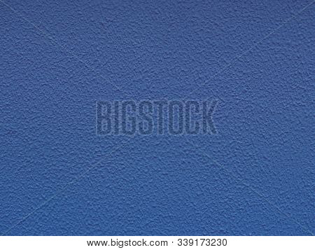 Blue Backdrop With Ornament.. Paper Texture. Dark Blue Stucco Surface. Concrete Wall. Abstract Patte