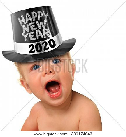 Happy New Year 2020 baby boy. Toddler wearing a happy New Year top hat, with a surprised expression on his face.