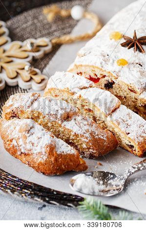 Holiday Baking. Christmas Cake. Stollen Is Fruit Bread Of Nuts, Spices, Dried Or Candied Fruit, Coat