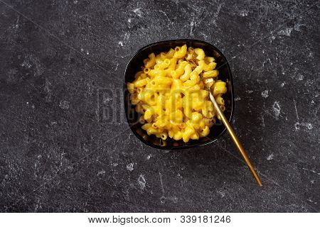 Macaroni And Cheese In A Bowl On Dark Background