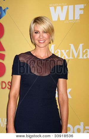LOS ANGELES - JUN 12:  Jenna Elfman arrives at the City of Hope's Music And Entertainment Industry Group Honors Bob Pittman Event at Beverly Hilton Hotel on June 12, 2012 in Beverly Hills, CA