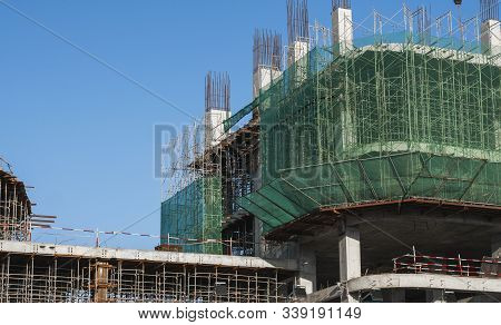 Building And Construction Site In Progress. Building Construction Site Against Blue Sky. Metal Const