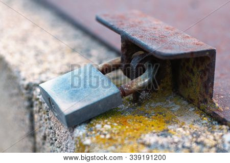 A Simple Lock Closing The Lid Of The Rusty Hatch