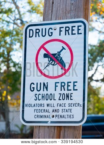 Drug Free and Gun Free School Zone sign in New Orleans, Louisiana, USA. poster