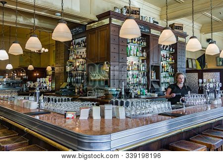 Melbourne, Australia - November 17, 2009: Belgian Beer Café Bluestone. The Large Bar With One Female