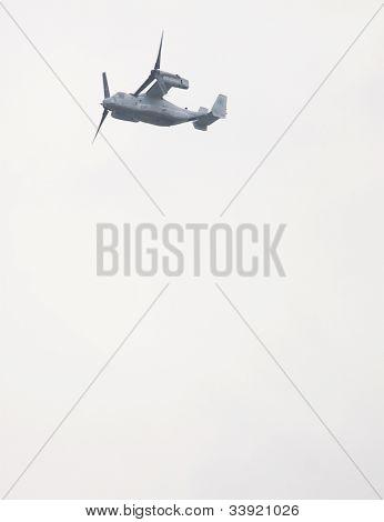 HOBOKEN, NJ - MAY 23: A military Osprey aircraft flies along the Hudson River near Manhattan during the Parade of Sails on May 23, 2012 in Hoboken, NJ. The parade marks the beginning of Fleet Week.