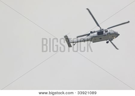 HOBOKEN, NJ - MAY 23: A military helicopter flies along the Hudson River near Manhattan during the Parade of Sails on May 23, 2012 in Hoboken, NJ. The parade marks the beginning of Fleet Week.