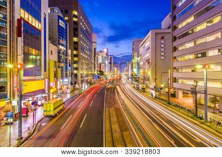 Hiroshima, Japan cityscape view above Aioi-Dori Avenue, the central commercial district in downtown at twilight.