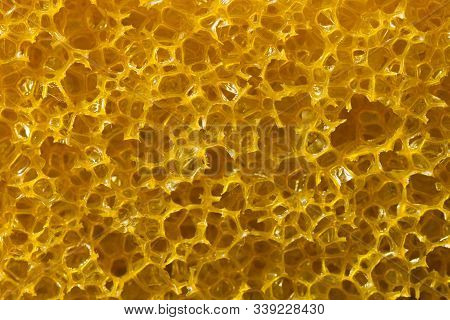 Abstract Yellow Sponge Texture Background. Close-up Texture Of Yellow Sponge Background.