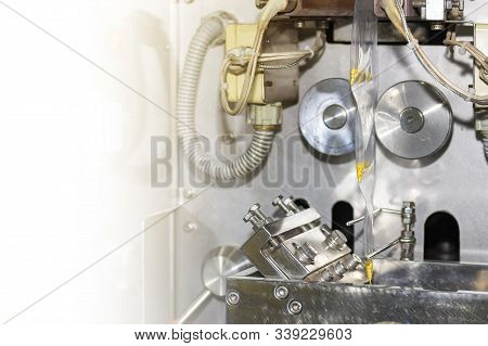 Close Up Goods And Envelope Plastic Bag During Put Seal And Cut By Continuous Vertical Automatic Sea