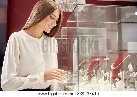 Beautiful Smiling Girl With Long Straight Hair Wearing White Silk Blouse Looking At Window Case With