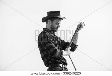 Thoughtful Farmer Thinking About Business. Life At Ranch. Cowboy With Lasso Rope Sky Background. Ran