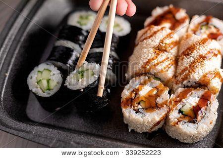 Sushi Roll With Cucumber, Cream Cheese, Eel And Unagi Sauce. Japan Restaurant Menu. Selective Focus