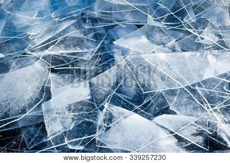 Winter Magic Frozen Ice Floes. Background Of Cracked Ice.