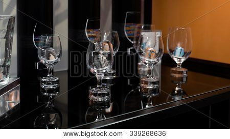 Coffee Capsules In Transparent Glasses On A Black Background. Coffee Shop Showcase Selling Granular