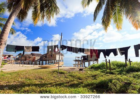Sea gypsy village at Kalapuan island near Borneo in Malaysia poster