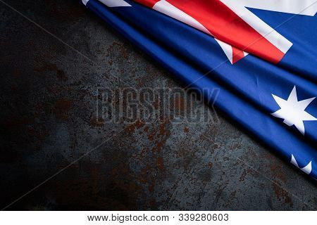 Australia Day Concept. Australian Flag With The Text Happy Australia Day Against A Black Stone Textu