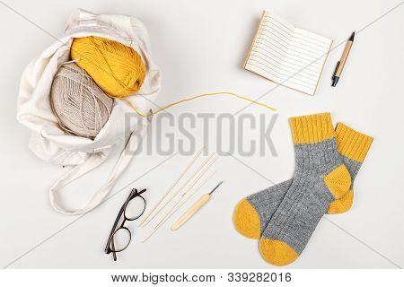 Yellow And Beige Clews Of Yarn In Textile Bag, Notebook, Pen For Writing, Glasses, Knitted Two-tone