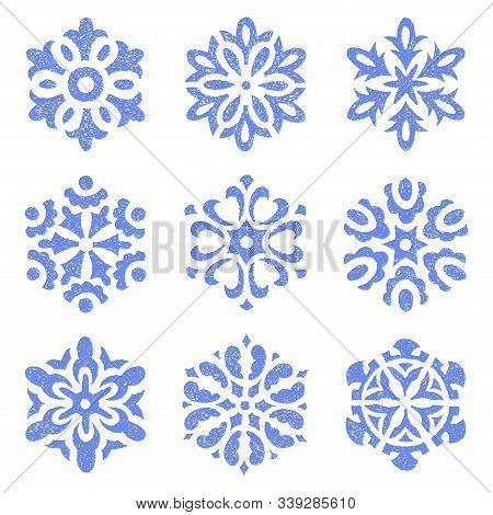 Set Of Vintage Snowflakes Drawn On Paper By Hand. Blue Isolated Flakes On A White Background. Winter