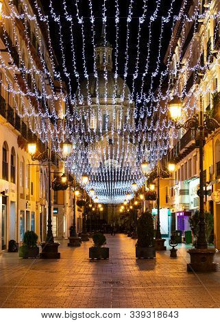 Zaragoza, Spain/europe; 11/12/2019: Night View Of Alfonso Street Decorated With Christmas Lights Wit